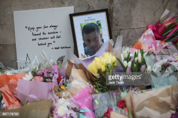 Floral tributes and a photograph of PC Keith Palmer lay outside the the Houses of Parliament following Wednesday's attack on Westminster on March 24...