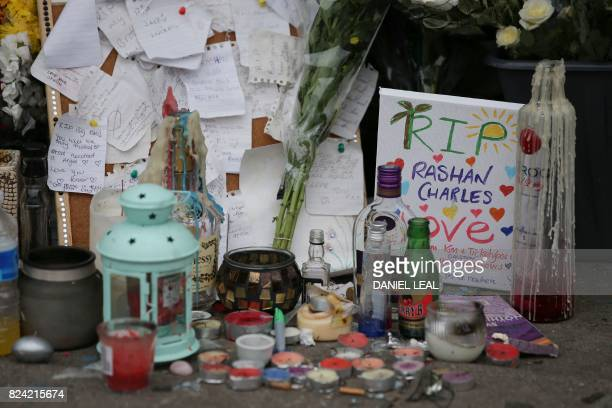 Floral tributes and candles for Rashan Charles whose death after being followed by police into a convenience store and allegedly apprehended has...