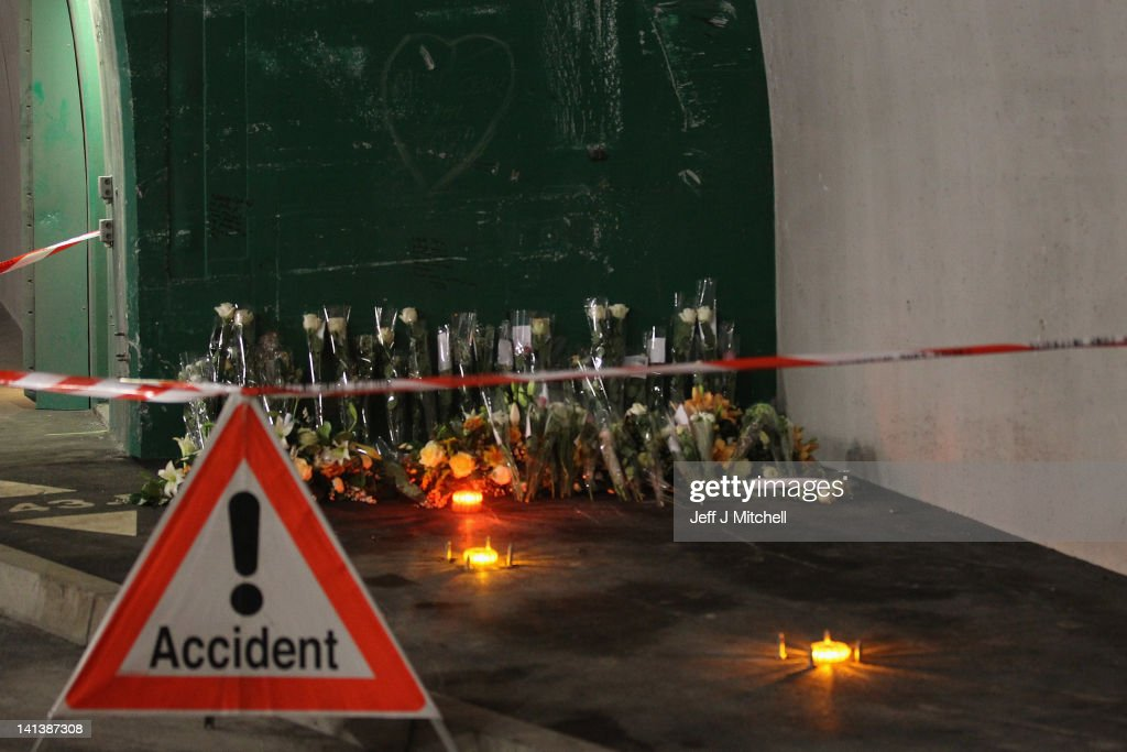 Floral tributes and candles laid by the families at the scene in the road tunnel where the 22 Belgian school children, four teachers and two drivers died in a coach crash, on March 15, 2012 in Sierre, Valais, Switzerland. The accident occurred on March 14, when a coach carrying 11-12 year old shcoolchildren returning from a skiing holiday crashed into a tunnel, killing 28 of the 52 passengers.