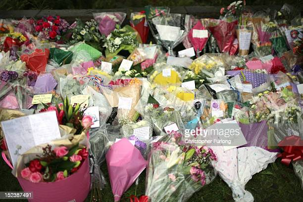 Floral tributes are laid by wellwishers at the scene of the shooting of WPCs Nicola Hughes and Fiona Bone in Hattersley on September 20 2012 in...