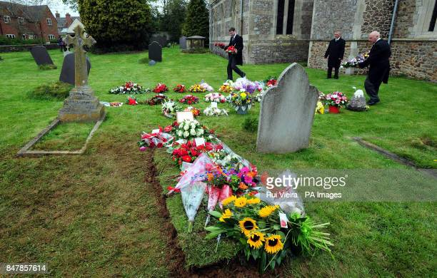 Floral tributes are left at the graveside after the funeral of Claire Squires at St Andrew's Church in North Kilworth Leicestershire after she...