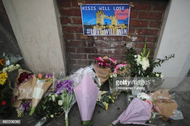 Floral tributes are left near the scene of last night's terrorist attack on June 4 2017 in London England Police continue to cordon off an area after...