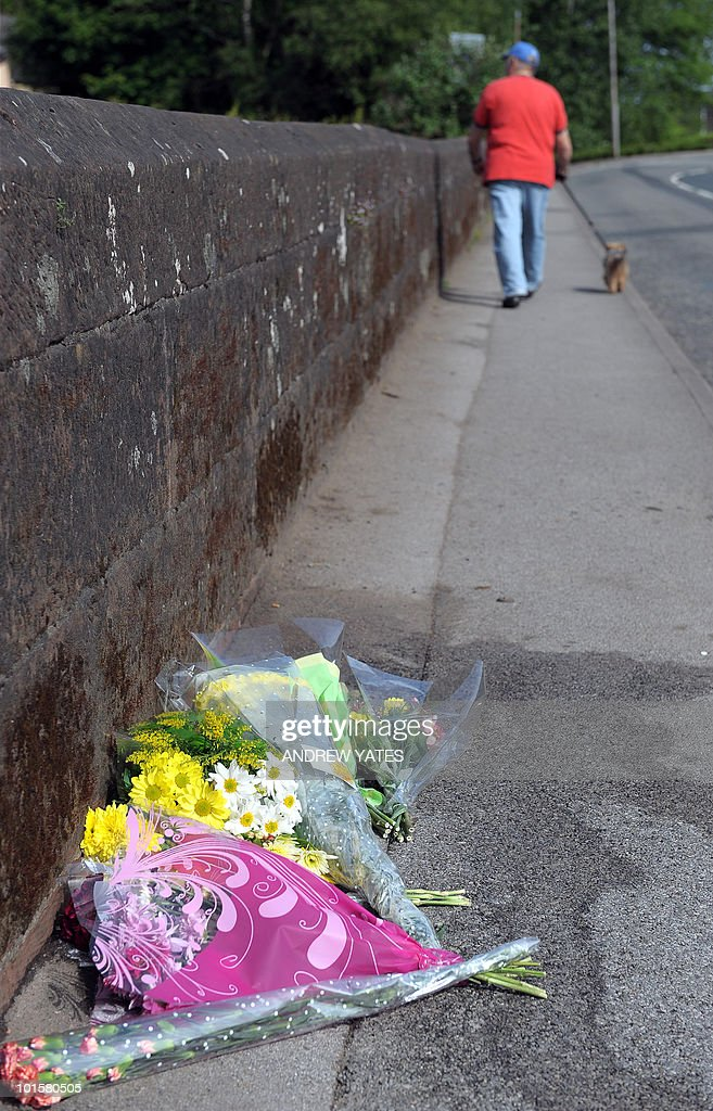 Floral tributes are left on a bridge on South Street in Egremont, Cumbria, on June 3, 2010, for a victim shot by lone gunman Derrick Bird on Wednesday. Friends and neighbours of Derrick Bird, who killed 12 people on a shooting spree in northern England, have expressed shock that a 'normal bloke' could wreak such devastation. But there were reportedly some prior warnings of the killings, which media reports suggest could have been caused by a family feud or a row at work -- and which caused the normally composed Bird to explode.