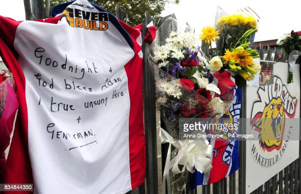 Floral tributes are left on the gates of Belle Vue in Wakefield the home ground of Wakefield Trinity Wildcats in memory of player Adam Watene who...