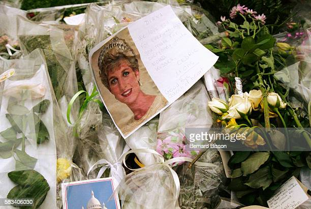 Floral tributes are placed in memory of Diana Princess of Wales following her death in a car crash on the Pont d'Alma on August 31 1997