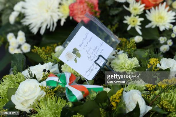 Floral tributes are seen at the Derry City Cemetery on March 23 2017 in Londonderry Northern Ireland The funeral is held for Northern Ireland's...