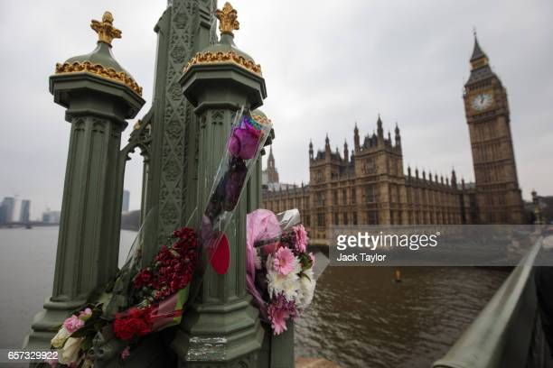 Floral tributes are seen on Westminster Bridge on March 24 2017 in London England A fourth person has died after Khalid Masood drove a car into...