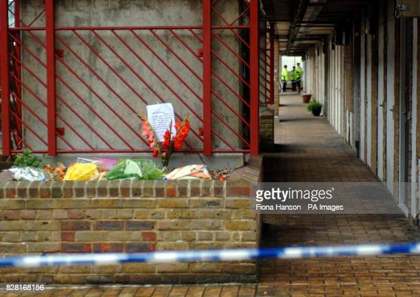 Floral tributes behind a police line on the Milford Towers estate in Catford south London Friday September 30 where the body of Rochelle Holness was...