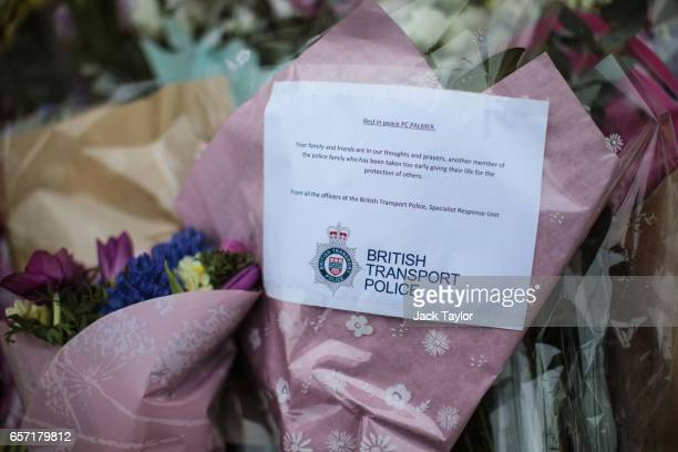 Floral tributes from the British Transport Police for PC Keith Palmer lay outside the the Houses of Parliament following Wednesday's attack on...