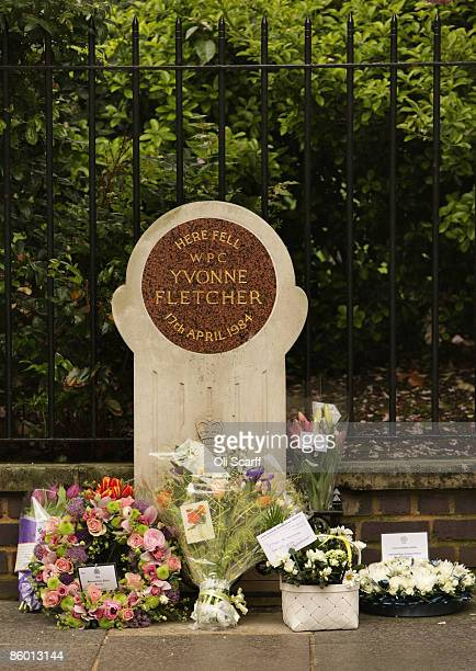 Floral tributes lay in front of a memorial stone for WPC Yvonne Fletcher on the 25th anniversary of her killing on April 17 2009 in London England...