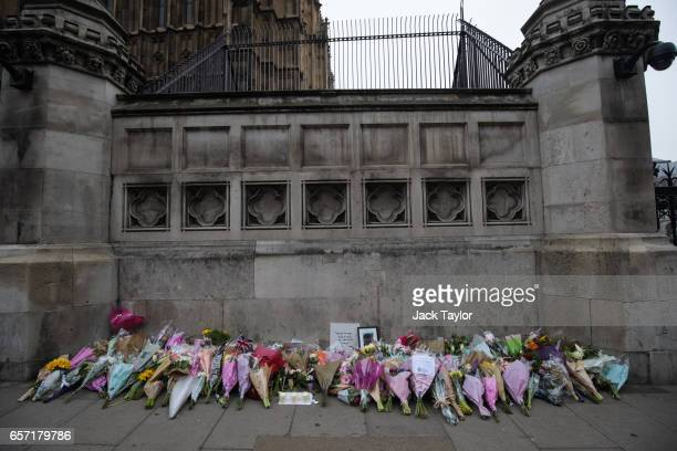Floral tributes lay outside the the Houses of Parliament following Wednesday's attack on Westminster on March 24 2017 in London England A fourth...