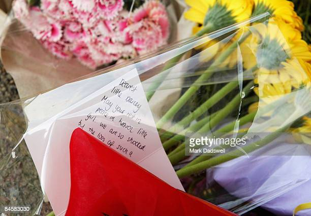Floral tributes lay placed at the site where fouryearold Darcey Freeman was allegedly thrown last week by her father Arthur Phillip Freeman 58metres...