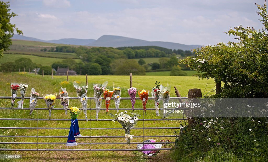 Floral tributes left at the site where Rugby League player Garry Purdham was shot dead by Derrick Bird yesterday, in Boonwood, Gosforth, in Cumbria, north west England on June 3, 2010. A string of scenic villages were struggling to come to terms with the massacre of 12 people among the quiet lanes of one of Britain's most popular tourist areas. At least 12 people were dead when Bird ended his murderous spree on Wednesday June 2, 2010, shooting himself in a thickly wooded area near the forest of Boot. AFP PHOTO/Leon Neal