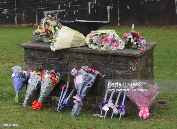 Floral tributes left at Tonyrefail School in memory of pupils Nikkita Marie Walters and KatieJo Davies who were killed in an air crash yesterday