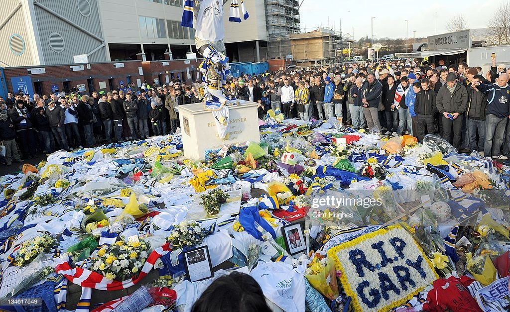 Floral tributes left in memory of Gary Speed lie at the foot of the Billy Bremner statue prior to kick off in the npower Championship match between Leeds United and Millwall at Elland Road on December 03, 2011 in Leeds, England.