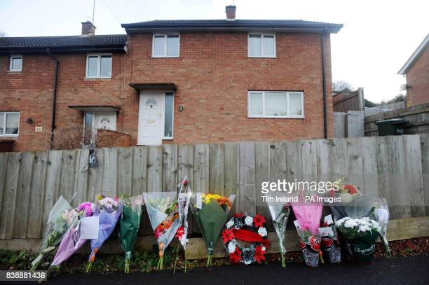 Floral tributes left outside a house on Mold Crescent in Banbury Oxfordshire where Sally Cox and 22yearold Martin Faulkner were murdered
