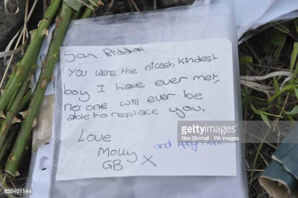 Floral tributes on a wall near the pavement where 11yearold Sam Riddall died after a car ploughed into him and his friends on Friday evening in...