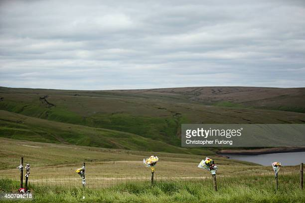 Floral tributes overlook Saddleworth Moor where the body of missing Keith Bennett may be buried on June 16 2014 in Saddleworth United Kingdom Fifty...