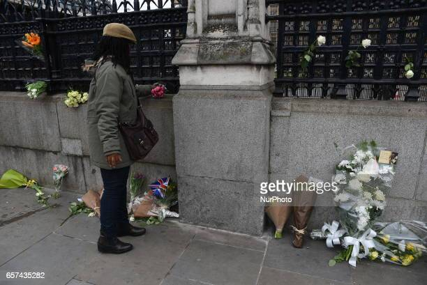 Floral tributes pictured near the Houses of Parliament in Westminster London on March 24 2017 The city is back to normal business but the police's...