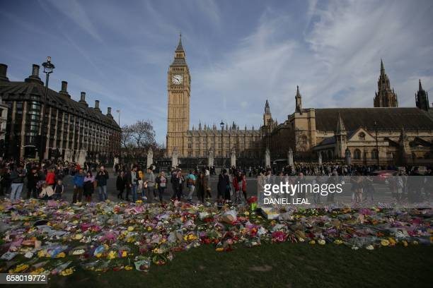 TOPSHOT Floral tributes to the victims of the March 22 terror attack are seen in Parliament Square in central London on March 26 2017 British police...