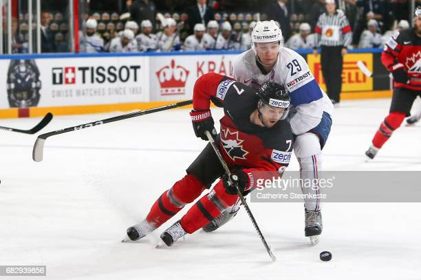 Floran Douay of France challenges Josh Morrissey of Canada during the 2017 IIHF Ice Hockey World Championship game between Canada and France at...