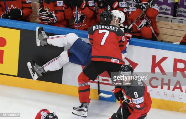 Floran Douay of France is slsah by Josh Morrissey of Canada during the 2017 IIHF Ice Hockey World Championship game between Canada and France at...