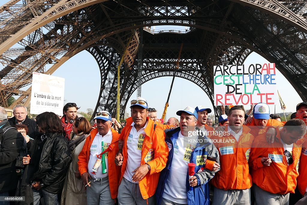 Florange's workers of the world's largest steel maker ArcelorMittal demonstrate under the Eiffel Tower on April 6 upon their arrival in Paris after a...