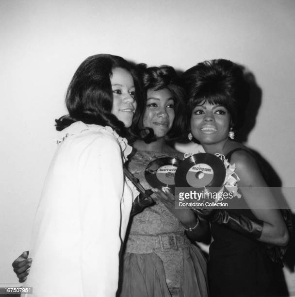 Florence Ballard Mary Wilson and Diana Ross of the singing group 'The Supremes' pose for a portrait holding a Motown record in circa 1964 in Los...