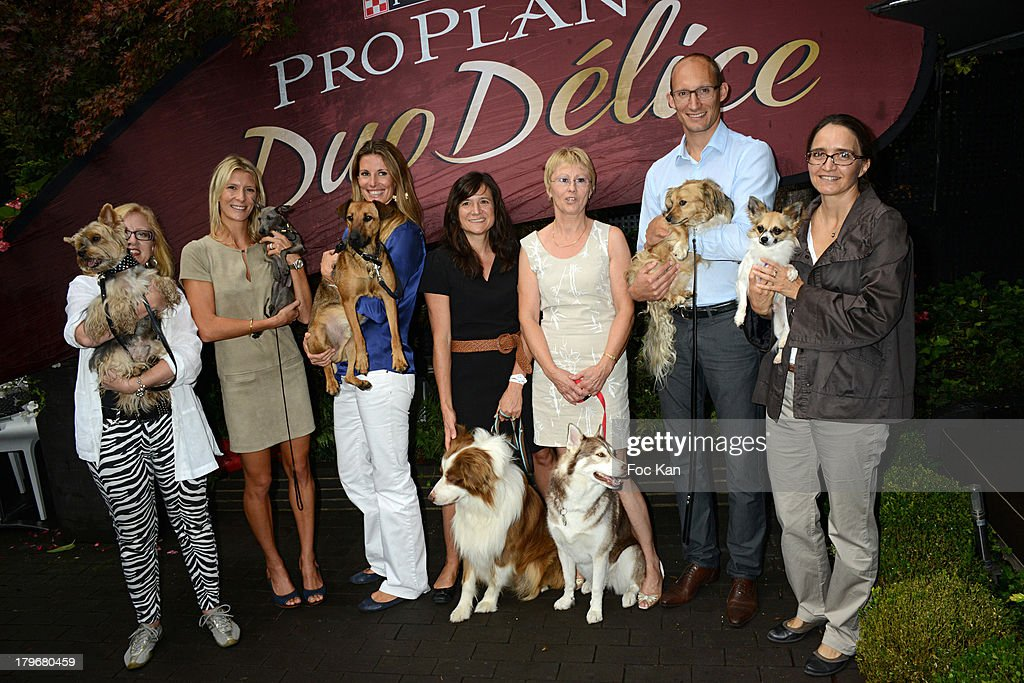 Florence Batisse Pichet, Helene Boucher, Sophie Thalmann, Clementine Jean Philippe, Isabelle Aaron, a guest and Katia Renard attend the Duo Delice Dog Food Launch Party at 6 Mandel on September 6, 2013 in Paris, France.