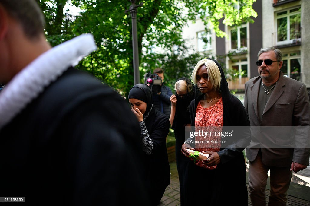 Florence C. (C), the mother of Islamic State fighter Florent Prince N., a 17-year-old also called Bilal, arrives at the St. Pauli Church prior to an interfaith memorial service for him on May 27, 2016 in Hamburg, Germany. Florent was born in Cameroon and grew up as a Christian in Hamburg, where he eventually converted to Islam and became radicalized. In May of 2015 he traveled to Syria, joined the Islamic State and was killed that summer. While still a Christian Florent was active in the St. Pauli Church community.
