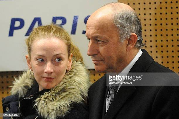 Florence Cassez and French Foreign minister Laurent Fabius pause during a press conference at the Roissy airport on January 24 2013 in Paris France A...