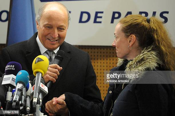 Florence Cassez and French Foreign minister Laurent Fabius speak during a press conference at the Roissy airport on January 24 2013 in Paris France A...