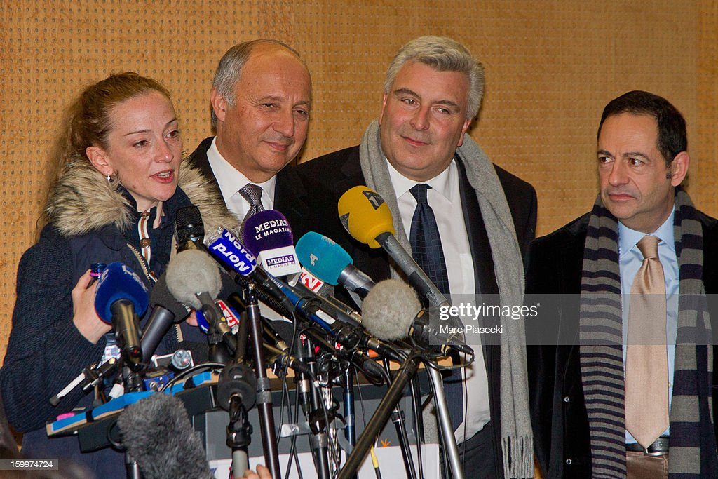 Florence Cassez, French Foreign Minister Laurent Fabius, Marc-Philippe Daubresse and Jean-Luc Romero attend a Press conference following her release from prison in Mexico at Charles-de-Gaulle airport on January 24, 2013 in Paris, France. A Supreme Court in Mexico voted to free Florence Cassez, 38, from France who was serving out a 60-year sentence for kidnapping. The decision was made after it was decided her rights were violated by a television broadcast of a staged raid on the kidnappers by the police when in fact the alleged kidnappers, including Cassez, were arrested the previous day on a highway.