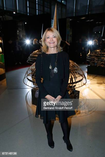 Florence De Botton poses in front the works of JeanPaul Goude during the 'Societe des Amis du Musee d'Art Moderne du Centre Pompidou' Dinner Party...