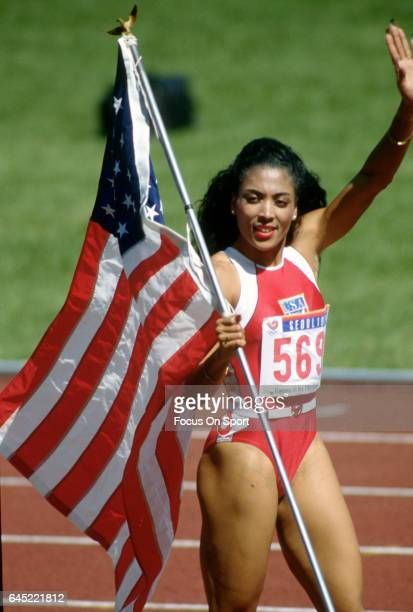Florence Griffith Joyner of the United States carrying the American Flag after winning a race in the Games of the XXIV Olympiad at the 1988 Summer...