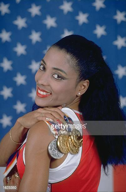 Florence Griffith Joyner of the United States displays her medals at the 1988 Olympic Games during a studio feature in Seoul South Korea Mandatory...