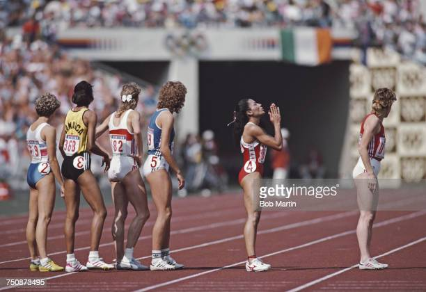 Florence Griffith Joyner of the United States prays before taking the baton for her leg of the Women's 4 v 400 metres race at the XXIV Summer Olympic...
