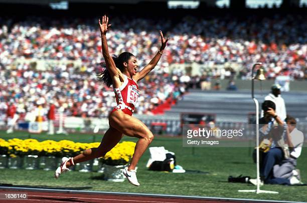 Florence Griffith Joyner of the USA celebrates her 100m win during the 1988 Olympic Games in Seoul Korea Mandatory Credit Allsport UK /Allsport