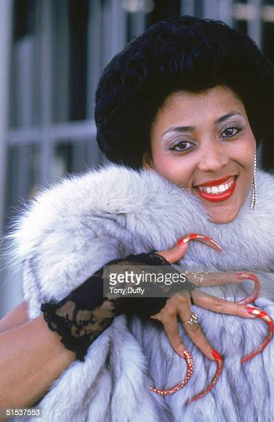 Florence Griffith Joyner poses for a portrait in 1986