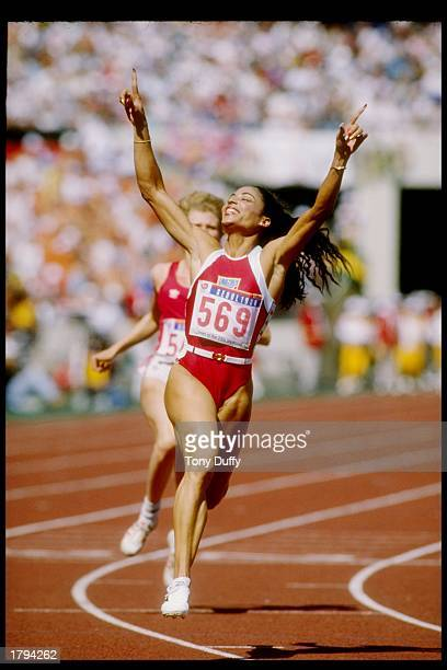 Florence GriffithJoyner celebrates after winning the 100 meters during the Olympic Games in Seoul South Korea