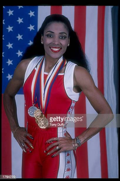 Florence GriffithJoyner poses for a picture with her medals won at the Olympic Games in Seoul South Korea
