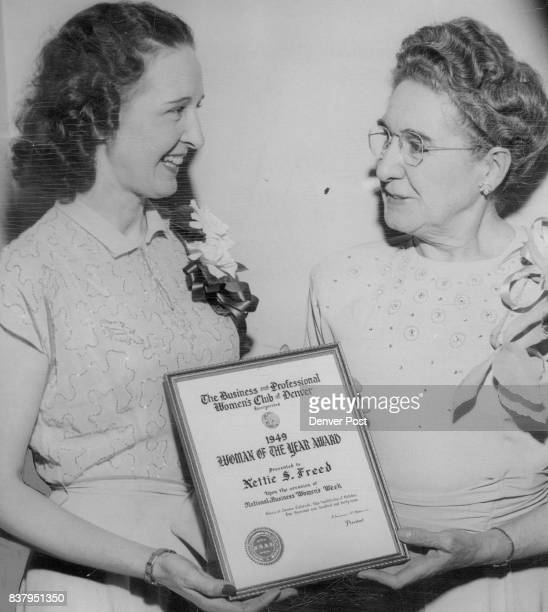 Florence H Morris president of the Business and professional Women's club of Denver presents the '1949 woman of the Year Award' to Mrs Nettie S Freed...
