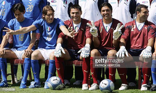 Italian forward Francesco Totti jokes with teammates Filippo Inzaghi Marco Amelia Gianluigi Buffon and Angelo Peruzzi as they pose for the official...