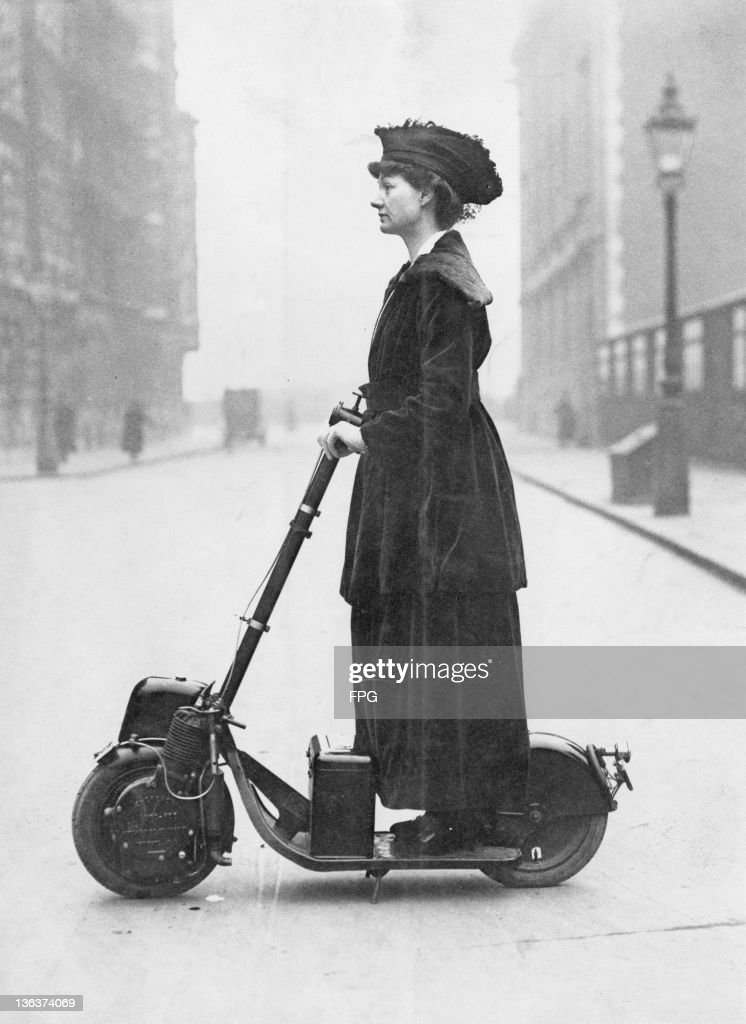 Florence, Lady Norman (nee McLaren, 1884 - 1964), travelling on her motor scooter to the offices, which she supervises as a war-worker, London, circa 1916. The scooter was a birthday present from her husband, the journalist and Liberal politician Sir Henry Norman.