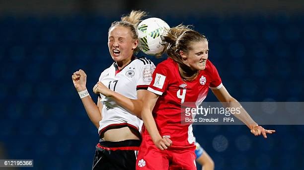 Florence Laroche of Germany jumps for a header with Sophia Kleinherne of Canada during the FIFA U17 Women's World Cup Jordan Group B match between...