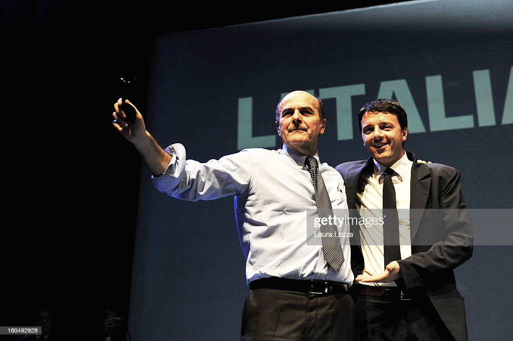 Florence Mayor <a gi-track='captionPersonalityLinkClicked' href=/galleries/search?phrase=Matteo+Renzi&family=editorial&specificpeople=6689301 ng-click='$event.stopPropagation()'>Matteo Renzi</a> (R) appears onstage with Democratic Party candidate for prime minister <a gi-track='captionPersonalityLinkClicked' href=/galleries/search?phrase=Pierluigi+Bersani&family=editorial&specificpeople=4182508 ng-click='$event.stopPropagation()'>Pierluigi Bersani</a> at a political rally on February 1, 2013 in Florence, Italy. Renzi was defeated by Bersani December 2 in a primary run-off race. Recent opinion polls show former Prime Minister Silvio Berlusconi, a billionaire media magnate, surging to within 5 percentage points of Bersani ahead of the February 24-25 vote.