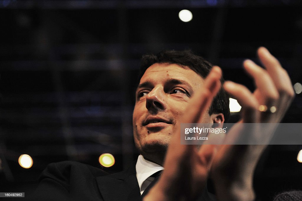 Florence Mayor <a gi-track='captionPersonalityLinkClicked' href=/galleries/search?phrase=Matteo+Renzi&family=editorial&specificpeople=6689301 ng-click='$event.stopPropagation()'>Matteo Renzi</a> applauds as Democratic Party candidate for prime minister Pierluigi Bersani speaks at a political rally on February 1, 2013 in Florence, Italy. Renzi was defeated by Bersani December 2 in a primary run-off race. Recent opinion polls show former Prime Minister Silvio Berlusconi, a billionaire media magnate, surging to within 5 percentage points of Bersani ahead of the February 24-25 vote.