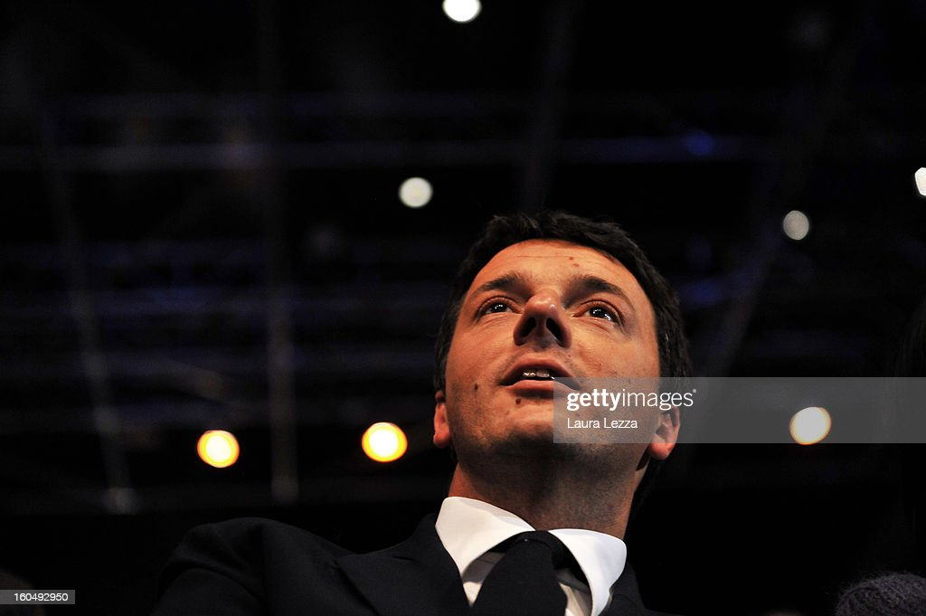 Florence Mayor <a gi-track='captionPersonalityLinkClicked' href=/galleries/search?phrase=Matteo+Renzi&family=editorial&specificpeople=6689301 ng-click='$event.stopPropagation()'>Matteo Renzi</a> listens as Democratic Party candidate for prime minister Pierluigi Bersani speaks at a political rally on February 1, 2013 in Florence, Italy. Renzi was defeated by Bersani December 2 in a primary run-off race. Recent opinion polls show former Prime Minister Silvio Berlusconi, a billionaire media magnate, surging to within 5 percentage points of Bersani ahead of the February 24-25 vote.