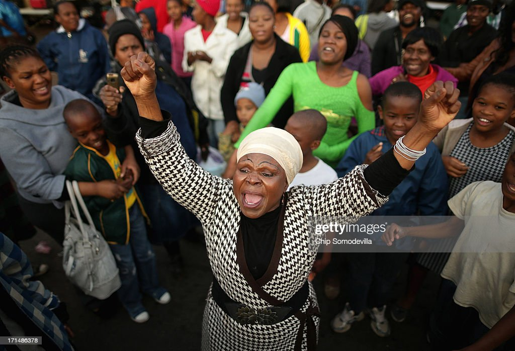 Florence Nyadzani (C), 58, leads people in songs and cheers of support outside of the Mediclinic Heart Hospital where former South African President Nelson Mandela is being treated June 25, 2013 in Pretoria, South Africa. 'I got my freedom because of Mandela,' Nyadzani said. 'We pray every day because we love him.' South African President Jacob Zuma confirmed on June 23 that Mandela's condition has become critical since he was admitted to the hospital over two weeks ago for a recurring lung infection.