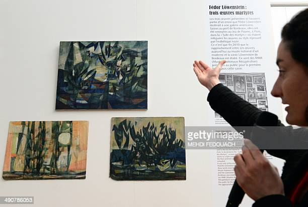Florence Saragoza an art curator for the exposition presents three artworks by Jewish Czech artist Fedor Lowenstein during an exposition at the...